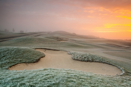 On the empty golf course in winter morning Stock Photo