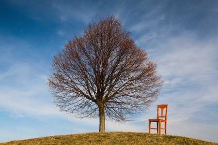 Lonely chair on the empty golf course in autumn Stock Photo - 18845837
