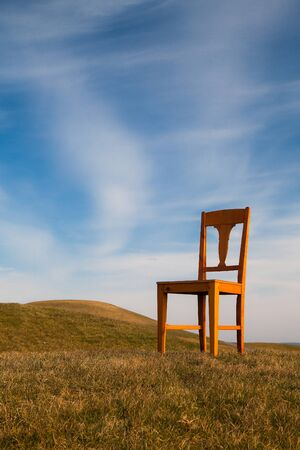 Lonely chair on the empty golf course in autumn Stock Photo - 18961763