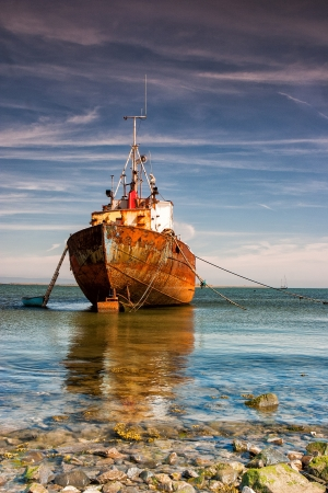 Old trawler on the beach in Rumpside
