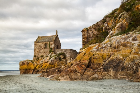 The small chapel on the coast near the Mont Saint Michel in Brittany photo