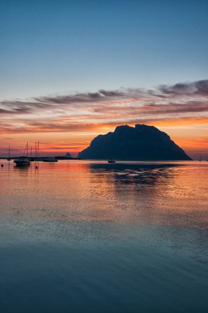 Famous Tavolara island at sunset on the Sardinia in Italy photo