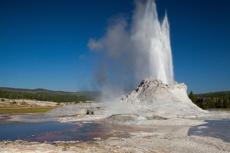 Geyser eruption in Castle Geyser in the Yellowstone National Park