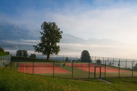 Outdoor tennis courts in the mountains photo