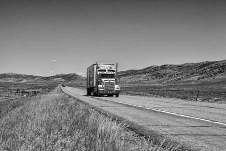 The typical American truck on the long highway in Wyoming photo