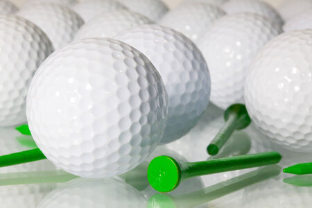 Different golf balls on a glass table photo