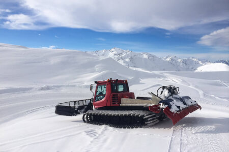 Modern red snow groomer on the empty slope Stock Photo - 25374897