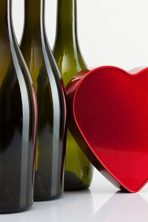 Empty bottles of wine and romantic symbol photo