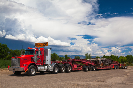 The typical american red Kenwood  truck on a parking place before heavy storm in Utah