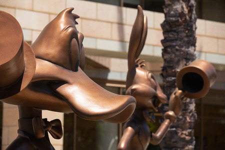 bugs bunny: Donald Duck and Bugs Bunny greeting visitors at the entrance to Warner Bros
