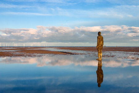 These spectacular sculptures by Antony Gormley are on Crosby beach  Another Place consists of 100 cast-iron, life-size figures spread out along three kilometres of the foreshore, stretching almost one kilometre out to sea