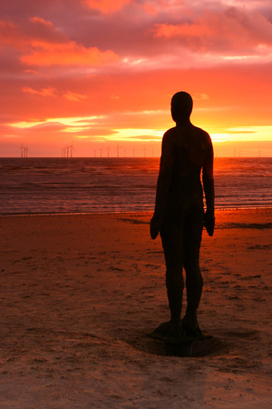 kilometres:  These spectacular sculptures by Antony Gormley are on Crosby beach  Another Place consists of 100 cast-iron, life-size figures spread out along three kilometres of the foreshore, stretching almost one kilometre out to sea
