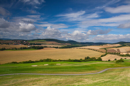 Detail of golf course in autumn landscape photo