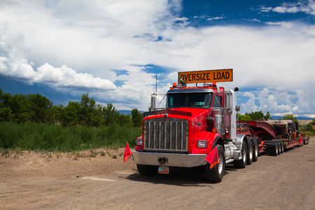 UTAH - JULY  18: The typical american red Kenwood  truck on a parking place before heavy storm in Utah, July 18, 2013