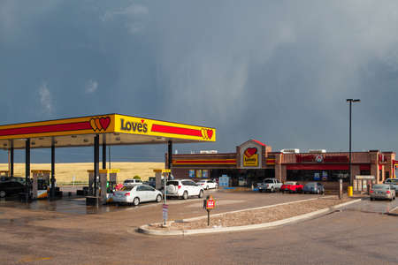 american field service: WYOMING,USA - JULY 27,2013: Typical americal petrol station near the Denver before heavy storm.