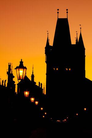 The silhouettes of towers and statues on Charles Bridge in Prague Stock Photo