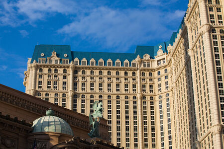 suggests: Las Vegas, USA - JULY 11 ,2011: Paris Las Vegas is a hotel and casino located on the Las Vegas Strip in Paradise, Nevada.As its name suggests, its theme is the city of Paris, France Editorial