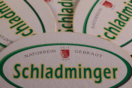 aftertaste: AUSTRIA, SCHLADMING - June 6, 2014: Beermats from Schladminger beer.Schladminger Beer has a full refreshing malty aroma with a slight bitter aftertaste
