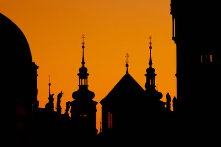 abbeys: The silhouettes of towers and statues on Charles Bridge in Prague Stock Photo