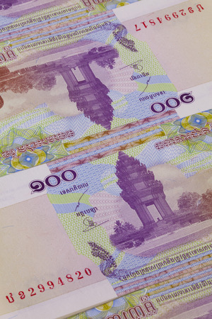 riel: Different Riel banknotes from Cambodia on the table Stock Photo