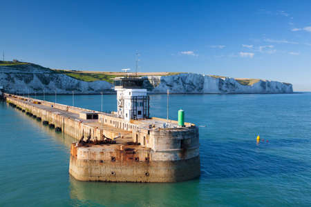 english channel: Dover,England-July 9,2013:White cliffs and Dover harbor along the coast of English channel