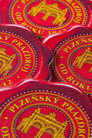 pilsener: Prague,Czech Republic-December 3,2014:Beermats from Pilsner beer.Pilsner Urquell Brewery  is a brewery in Plzen, the Bohemian city which is known as the birthplace of the Pilsener beer style in general.