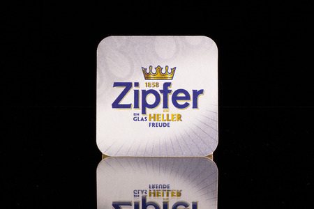begun: Wien,Austria-December 13,2014: Beermat from Zipfer beer.Its a new brewery by GermanAustrian standards, begun in 1858.