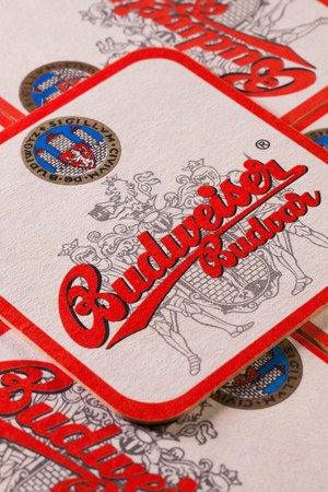 Prague,Czech Republic-December 3,2014:Beermats from Budweiser  beer.Budweiser Budvar beer is brewed only in Ceske Budejovice and is never licensed.