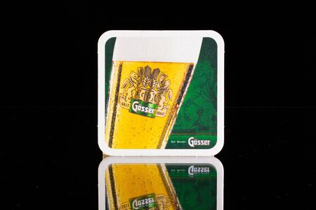 illustrative material: GERMANY,DRESDEN - September 20,2014:Beermat from Gosser beer.Gosser beer is the main brand of the Goss brewery in Leoben, one of the largest and most-well known Austrian beer breweries.