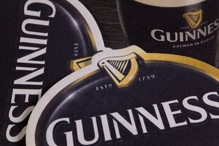 illustrative material: ENGLAND,LONDON - November 11, 2014: Beermats from Guinness beer.St. Jamess Gate Brewery is a brewery founded in 1759 in Dublin, Ireland, by Arthur Guinness. Editorial