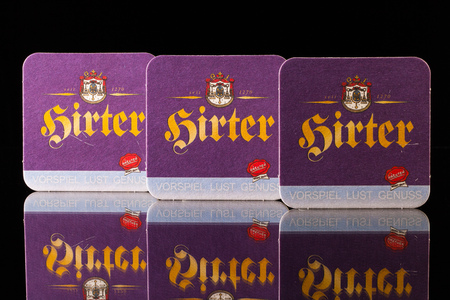 illustrative material: GERMANY,DRESDEN - September 20,2014:Beermats from Hirter beer.The Hirter beer is a brand of beer production, from a secretive brewery in Carinthia and exists since 1270.