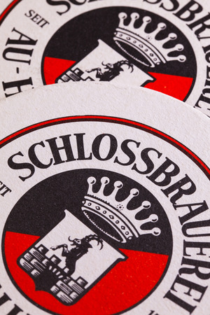 Berlin,Germany-December 12,2014:Beermats from  Schlossbrauerei beer.For more than 400 years the brewery has been taking care that the local traditional beers are supplied regionally as well as internationally.