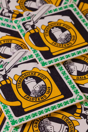 illustrative material: Brno,Czech Republic-August 1,2014:Beermats from Strakonice beer.The Strakonice Burghers Brewery is the last brewery in the Czech Republic to still be owned by a town.