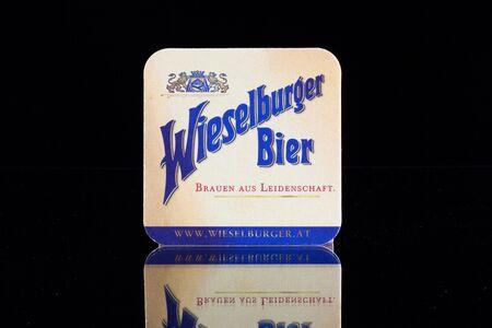 illustrative material: GERMANY,DRESDEN - September 20,2014:Beermats from Wieselburger Beer.It is brewed in Wieselburg, a town west of Vienna,
