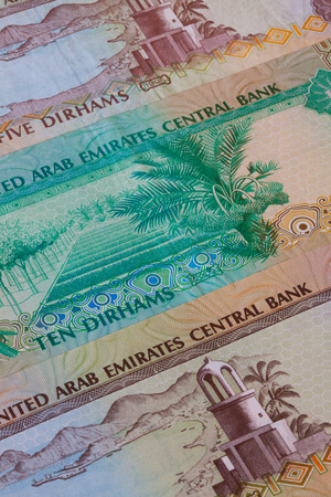 dirham: Different Dirham  banknotes from Emirates on the table