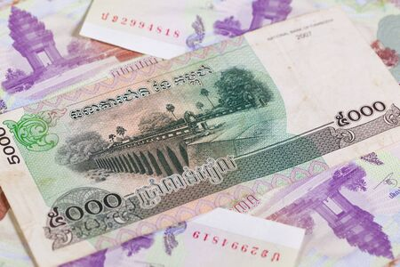 riel: Different Cambodia Riels banknotes on the table Stock Photo