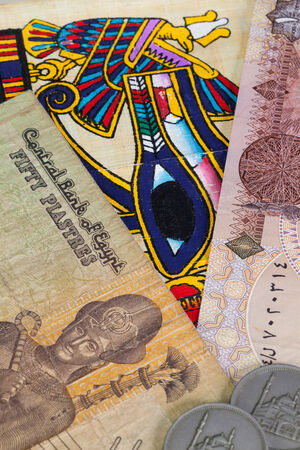 Typical Egyptian hieroglyphics on papyrus and different banknotes photo
