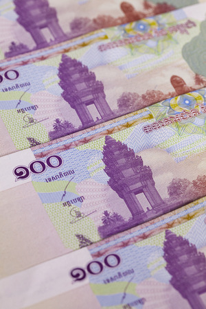 Different Cambodia Riels banknotes on the table Stock Photo