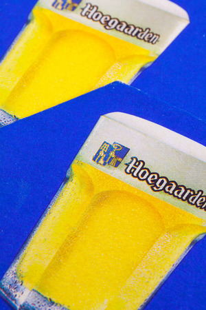 illustrative material: ENGLAND,LONDON - November 11, 2014:Beermats from Hoegaarden beer.Hoegaarden brewery is the producer of a well-known wheat beer.It is owned by InBev. Editorial