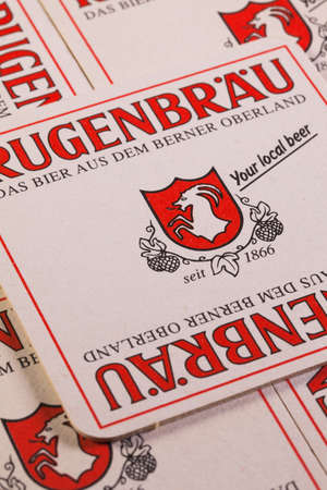 ag: Switzerland, Zürich-June 3, 2014: Beermats from Rugenbräu AG beer - it is a brewing company, headquartered in Matten bei Interlaken, Switzerland.