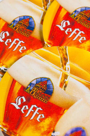 illustrative material: ENGLAND,LONDON - November 11, 2014: Beermats from Leffe Beer.Leffe, a brewing tradition since 1240. Founded in 1152, Notre-Dame de Leffe was an abbey of Premonstratensian canons.