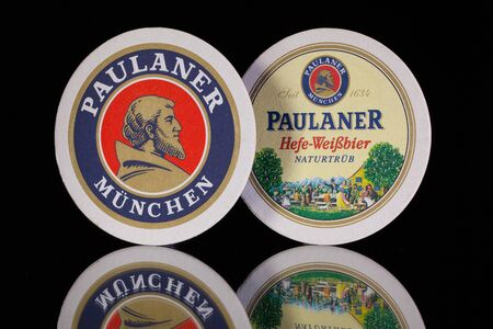 illustrative material: Germany,Berlin -December 12,2014:Beermats from Paulaner beer.Paulaner is a German brewery, established in 1634 in Munich by the Minim friars of the Neudeck ob der Au cloister. Editorial