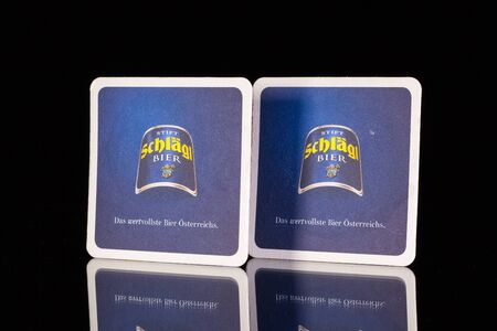illustrative material: Austria,Wien - December 15,2014:Beermats from Schlagl beer.Schlagl Beer exists since 1580. The beer was originally brewed by monks of the monastery in Schlagl.
