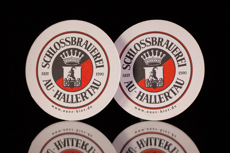 regionally: Germany,Berlin -December 12,2014:Beermats from  Schlossbrauerei beer.For more than 400 years the brewery has been taking care that the local traditional beers are supplied regionally as well as internationally.