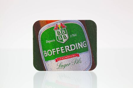 nationale: Germany,Berlin - January 7,2015:Beermat from Bofferding beer on a glass table.Brasserie Nationale is the largest brewery in Luxembourg, based in Bascharage.