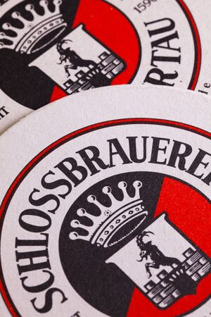 regionally: Berlin,Germany-December 12,2014:Beermats from  Schlossbrauerei beer.For more than 400 years the brewery has been taking care that the local traditional beers are supplied regionally as well as internationally.