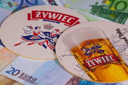 illustrative material: Brno, Czech Republic-January 11, 2015:Beermats from Zywiec beer and eur money.Zywiec Brewery is a brewery founded in 1852, in Zywiec, Poland.It was nationalised after the Second World War.