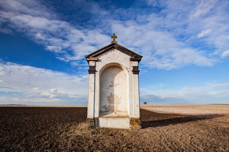 recollection: A small chapel in the middle of autumn fields Stock Photo