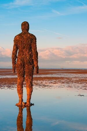 Crosby,Great Britain - September 18,2007: Spectacular sculptures are on Crosby beach.Another Place is a piece of modern sculpture by Antony Gormley. It consists of 100 cast iron sculptures of the artist s own body, facing towards the sea. Editorial