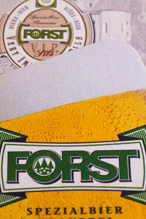 illustrative material: GERMANY,STRASBOURG-November 9,2014: Beermats from Forst beer.Forst is an Italian brewing company, based in Forst, a frazione (municipal subdivision) of Algund, South Tyrol